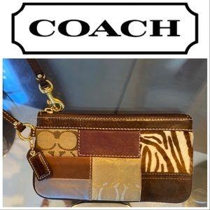 Coach patchwork wristlet- wallet.